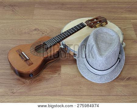 Close-up Of A Samba Player (sambista) Hat And Two Brazilian Musical Instruments: Cavaquinho (small A