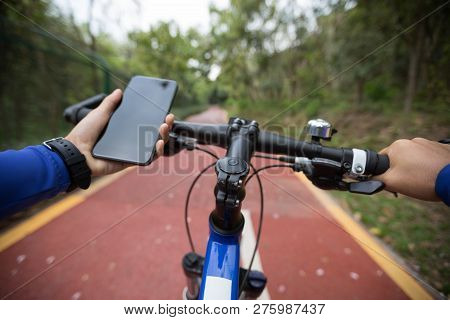 Use Smar Phone App For Navigation While Bike Ride On The Forest Trail