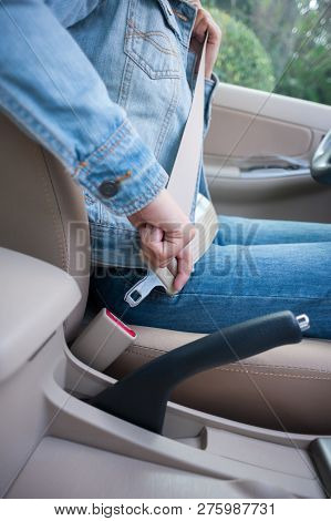 Woman Driver Buckle Up The Seat Belt Before Driving