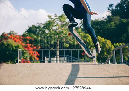 One Young Skateboarder Skateboarding On Skate Park