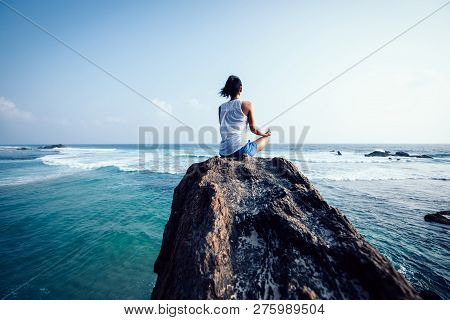 Yoga Woman Clothing In White Meditation At The Seaside Rock