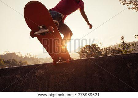One Young Skateboarder Skateboarding At Skatepark Ramp
