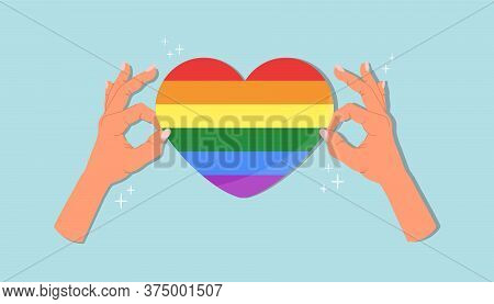 Pride Heart Sticker In Hands. Lgbt Pride Month In June. Lesbians, Gays, Bisexuals, Transgender Peopl