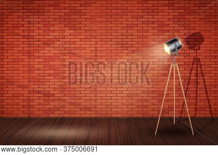 Interior Of Red Brick Wall And Spotlight Tripod Floor Lamp. Background Of Loft And Trendy Showroom O