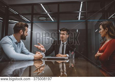 Lawyer Mediating A Dispute Between Wife And Husband