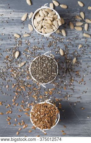 Sunflower Seeds, Flax Seeds And Chia On Blue Wooden Background