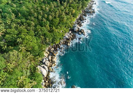Aerial View Of Crashing Waves On Rocks Landscape Nature View And Beautiful Tropical Sea With Sea Coa