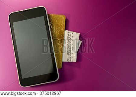 Mobile Phone Credit Card And Check Lie On A Purple Background. Web Banner. Business Concept.