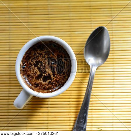 Cup Of Coffee And A Spoon Lie On A Napkin. Web Banner. Business Concept.