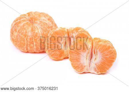 Fresh peeled mandarin isolated on white background
