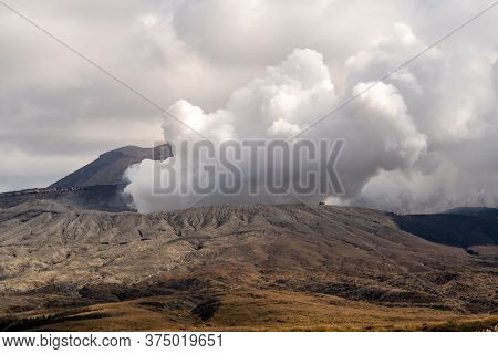 Close-up View Of Mount Aso (the Largest Active Vulcano In Japan) Venting Steam And Gases Before Erup