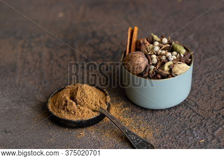 Different Spices Black And White Peppercorns, Cloves, Cinnamon, Mace, Cardamom, Cumin. Spice Blend O