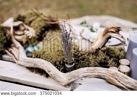 Bouquet Of Dried Lavender In Tiny Bottle On The Romantic Outing With Table Decoration, Candles, Drie