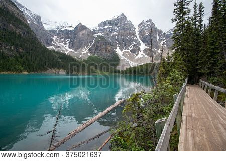 A Picture Of Moraine Lake Seen From A Small Bridge.   Ab Canada