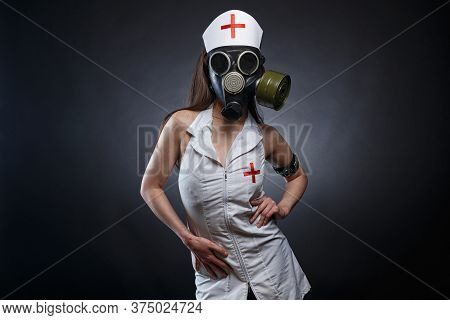 Image Of Young Brunette Nurse In Gas Mask