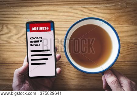 Covid-19 Business Impact News Concept. Businessman Read On Smart Phone News Or Analysis About Impact