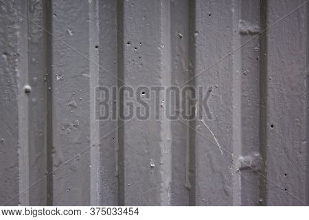 Corrugated Sheet Metal, Badly Painted With Grey Paint For Background. Metal Corrugated Roofing Sheet
