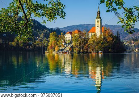 Stunning Touristic And Excursion Place At Autumn. Admirable Lake Bled With Famous Pilgrimage Church