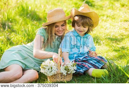 Spring Season. Happy Holidays. Cowboy Family Collecting Spring Flowers. Mother And Cute Son Having F