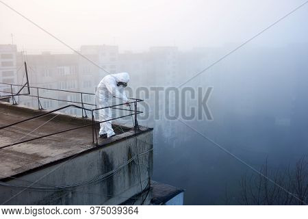Scientist Is Evaluating Territory On High Storey Building For His Research Regarding Global Pollutio