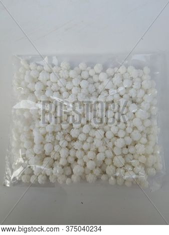 Plastic Pack Of Sugar Coated White Rough Balls For Making Pongal Distribution Food. Sugar Coated Whi