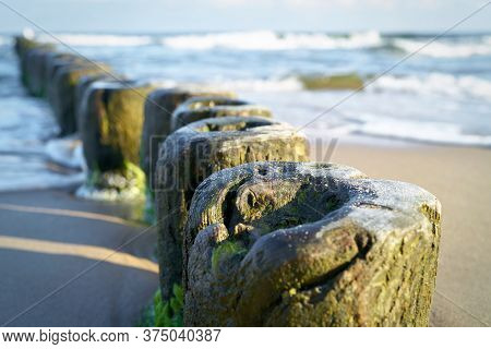 Breakwater On The Beach Of The Baltic Sea Near Rewal In Poland