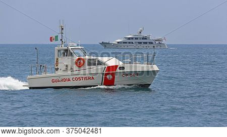 Amalfi Coast, Italy - June 28, 2014: Big Yacht And Coast Guard Boat Patrolling At Tyrrhenian Sea In
