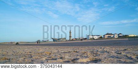Warnemuende, Germany - January 16, 2020: Beach Of Warnemünde In Germany With View Of The Landmarks L