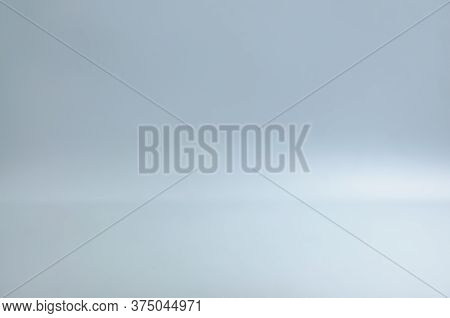 Blurred Blank Grey Gradient Background For Product Display. Grey Backdrop On Floor In Empty Studio R