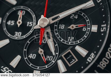 Black Watch Case And Dial. Wristwatch With Red Arrows Close-up. Macro