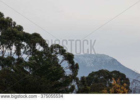 Beautiful Vegetation With Mixed Colours Autumn Foliage Over The Hills Of Tasmania With Kunanyi In Th