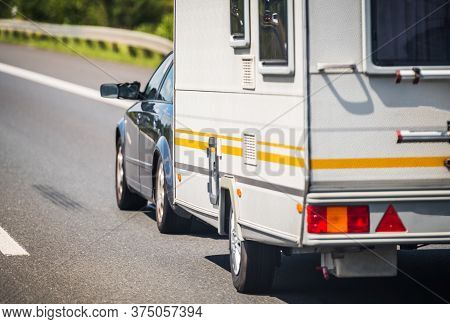Transportation And Recreation Theme. Summer Vacation With Small Travel Trailer. Compact Car Pulling
