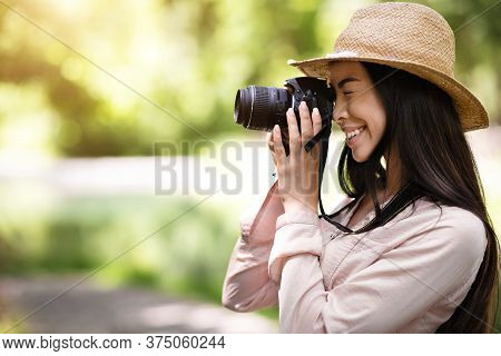 Photography Classes Concept. Young Asian Girl Student Taking Photo Outdoors With Digital Camera, Sid