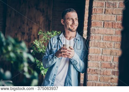 Photo Of Handsome Homey Guy Leaning Brick Design Wall Look Window Drink Hot Fresh Coffee Dreamy Imag