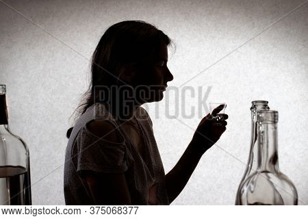 Woman Holds A Glass With Strong Alcohol. Female Alcoholism, Alcohol Addiction, Delirium Tremens. Sil