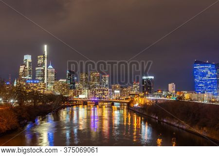 Night Cityscape of Philadelphia skyscraper Skylines building sunset along river in Philly city downtown of Philadelphia in PA USA. Cityscape Urban lifstyle concept.