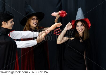 Portrait of group of friends asian young adult people wear Halloween costume to be witches and dracula character. Halloween celebrate and international holiday concept.