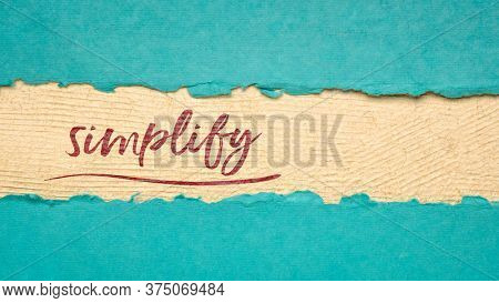 simplify reminder, pragmatic, declutter or get organized concept,  - handwriting on a handmade paper