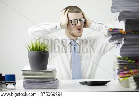 Overworked Young Businessman In Glass And Tie Grabbed His Head Depressed In Business Stress Sitting
