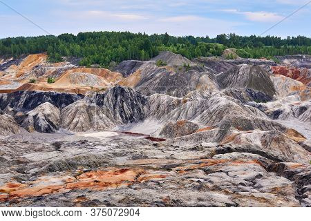 Multi-colored Eroded Hills And Destroyed Soil Layer At The Open Cast Mining Site Of Kaolin