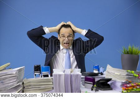 Composite Image Of Desperate Depressed Businessman Stressed Out At Work Grabbed His Head In Office W