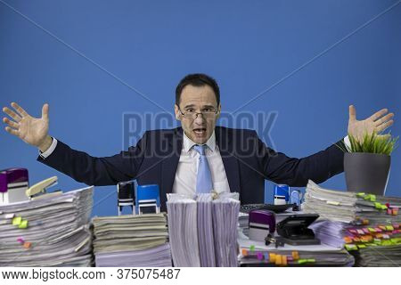 Tired Middle-aged Stressed And Overworked Businessman Wearing Glasses Shows With His Divorced Hands