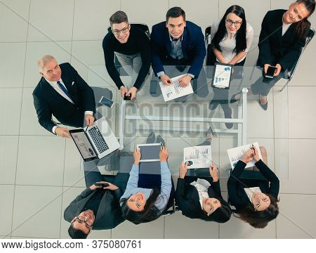Business Team Discussing Financial Data At A Working Meeting