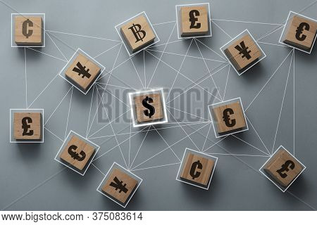 Multi Currency Sign Symbols Print Screen On Wooden Cubes Block And Connection Include Dollar Euro Po