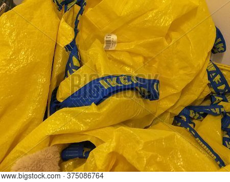 June 2020 Milan, Italy: Ikea Company Logo Icon On Yellow Trademark Bags Close-up. Ikea Visual Brand