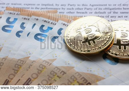 Top View Of Bitcoin With Euro Bills On The Table Near Contract. Crypto Currency Concept