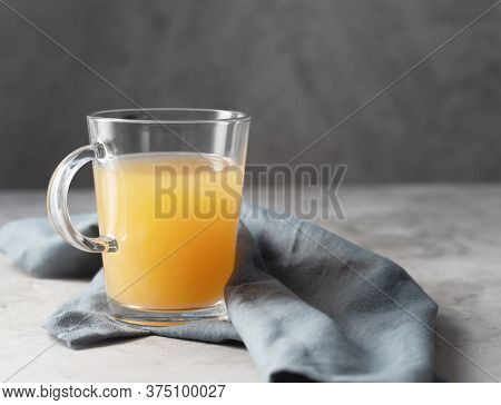 Homemade Beef Bone Broth In Glasses On A Gray Concrete Background