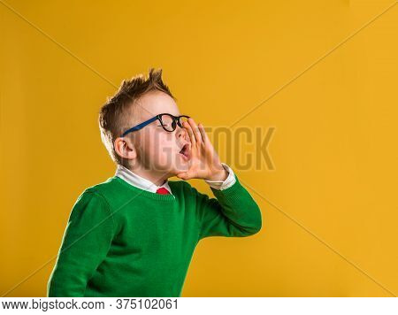 Child Screaming With Hand Like A Megaphone. News. Back To School. Kid Boy Make Announce