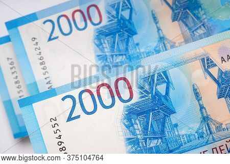 Russian Banknotes 2000 Rubles. The Bills Depict The Vostochny Space Center And The Soyuz Rocket. Vie