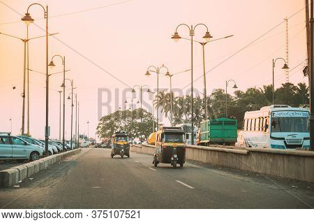 Goa, India - February 13, 2020: Auto Rickshaw Or Tuk-tuk Moving On Street In Sunny Day.